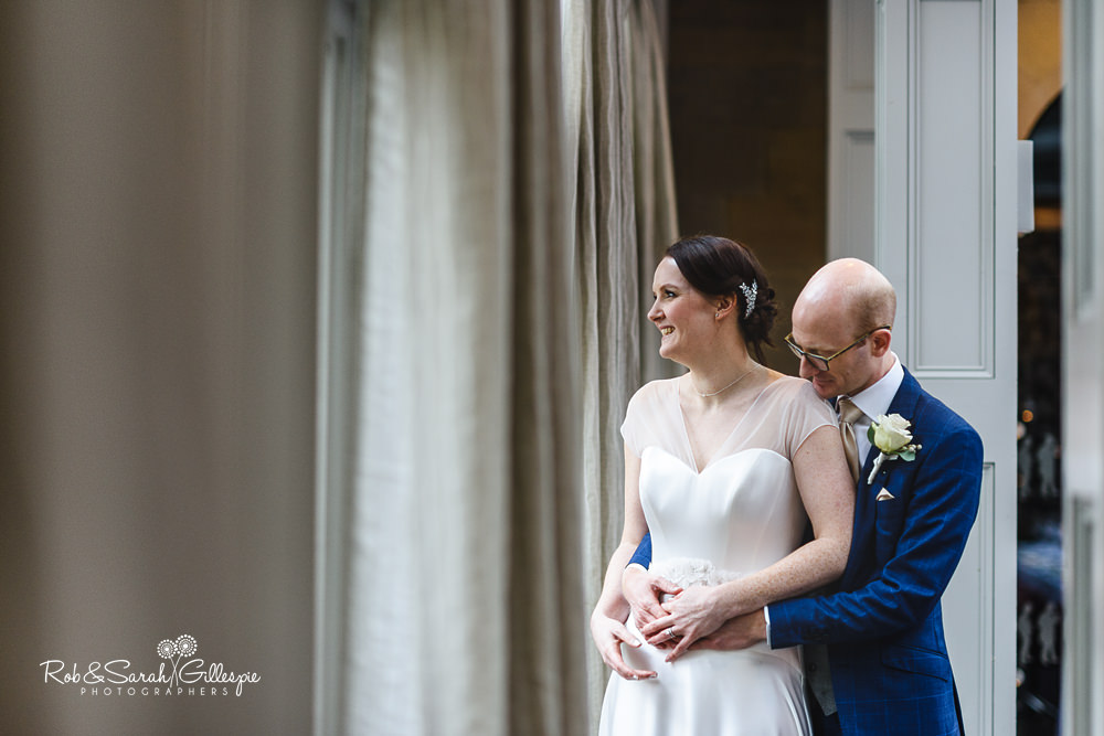 Bride and groom at Hampton Manor in window light