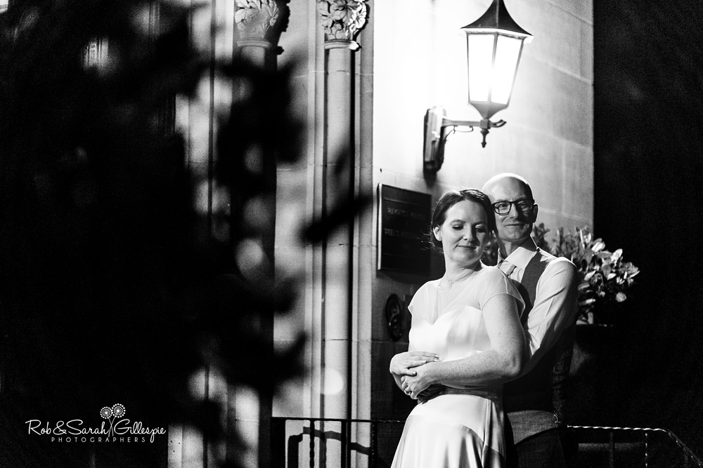 Bride and groom at Hampton Manor outside main entrance