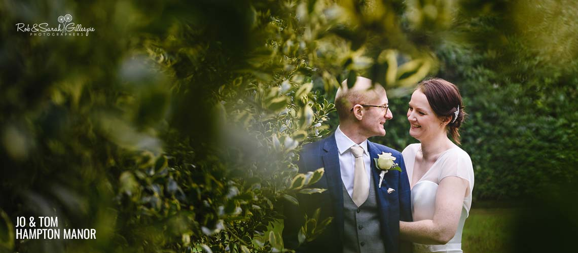 Bride and groom in gardens at Hampton Manor