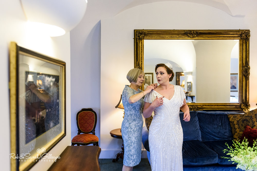 Bride having dress adjusted in Hansom Suite at Birmingham Town Hall