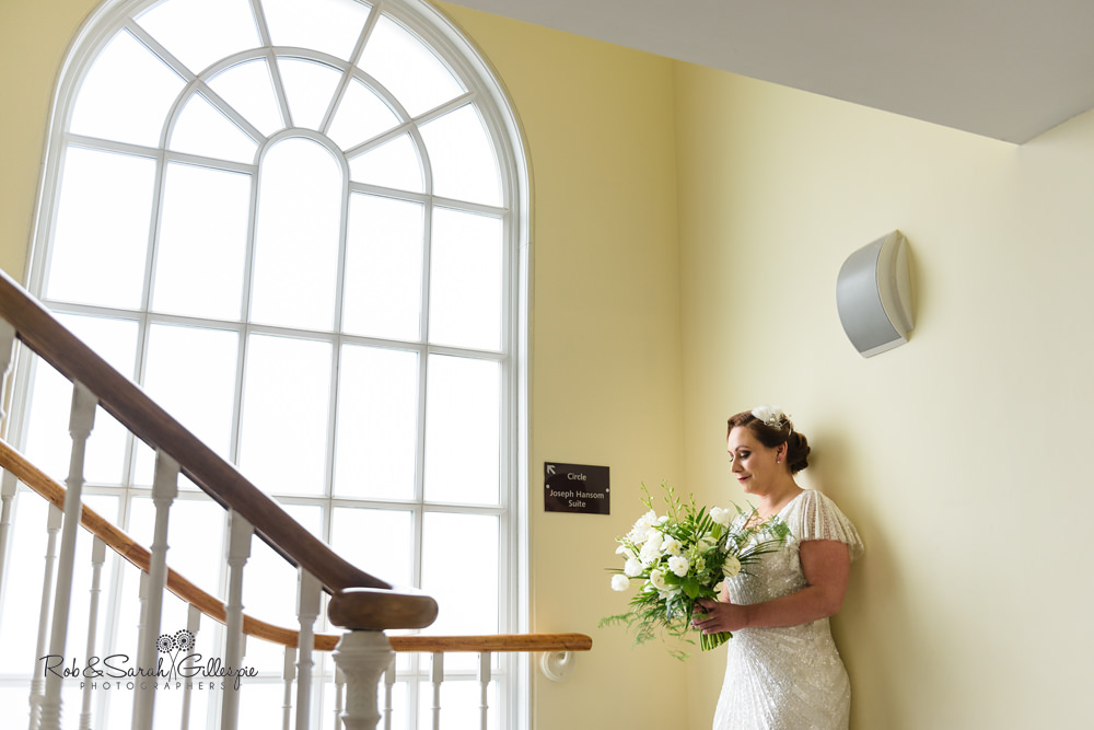 Portrait of bride next to large decorative window at Birmingham Town Hall