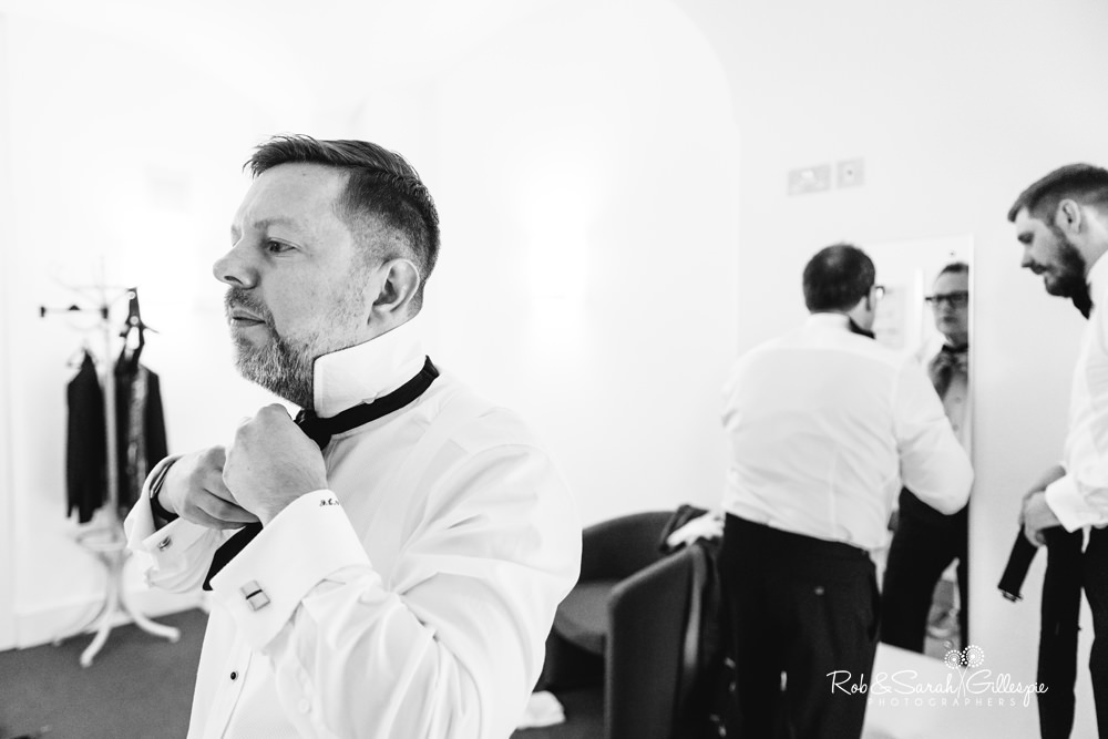 Groom and ushers prepare for wedding in Birmingham Town Hall dressing room