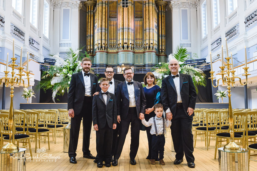 Group photo of groom, ushers inside Birmingham Town Hall