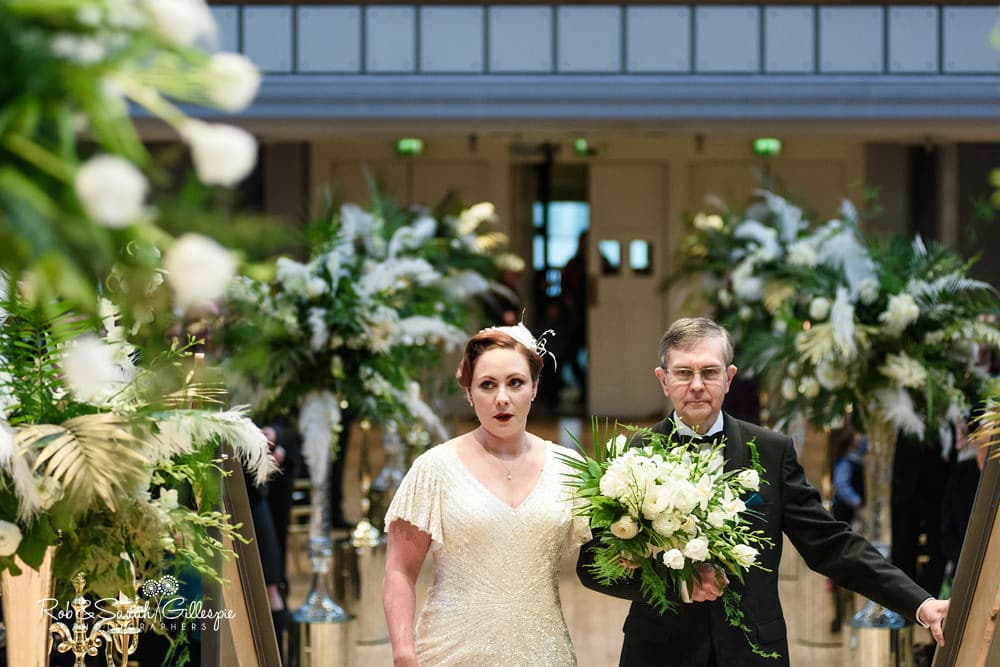 Bride and father walk up aisle at Birmingham Town Hall wedding ceremony
