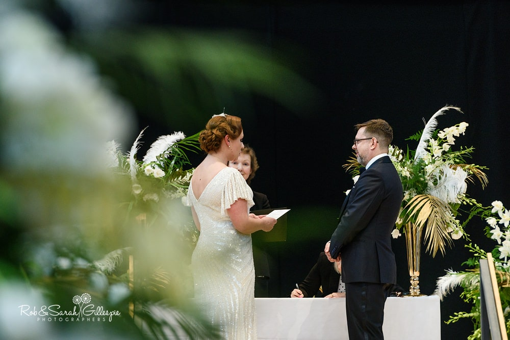 Bride and groom exchange wedding vows in Birmingham Town Hall