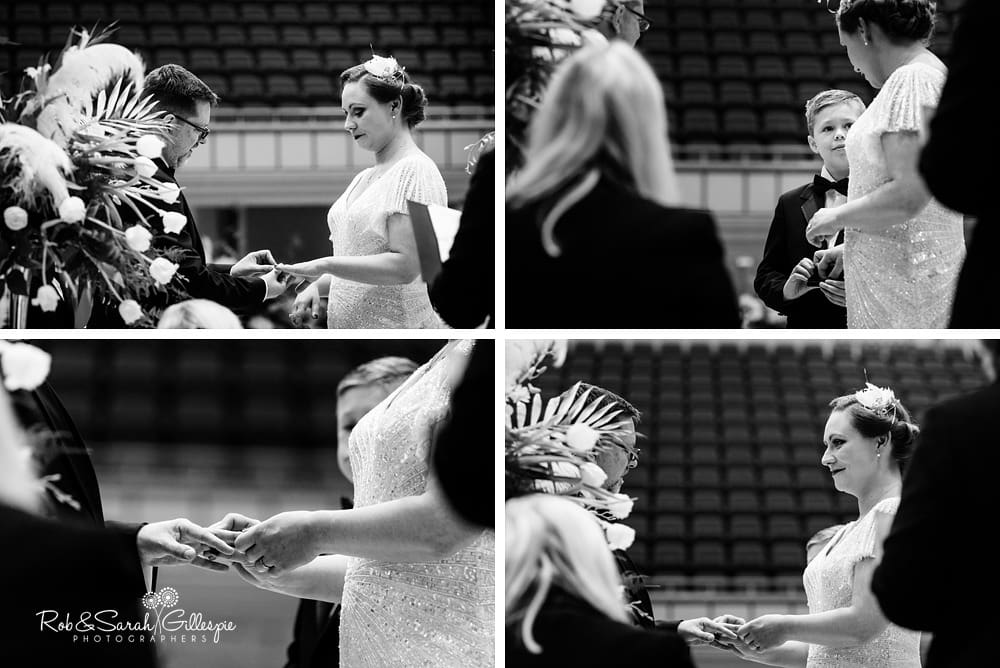Bride and groom exchange rings during Birmingham Town Hall civil wedding ceremony