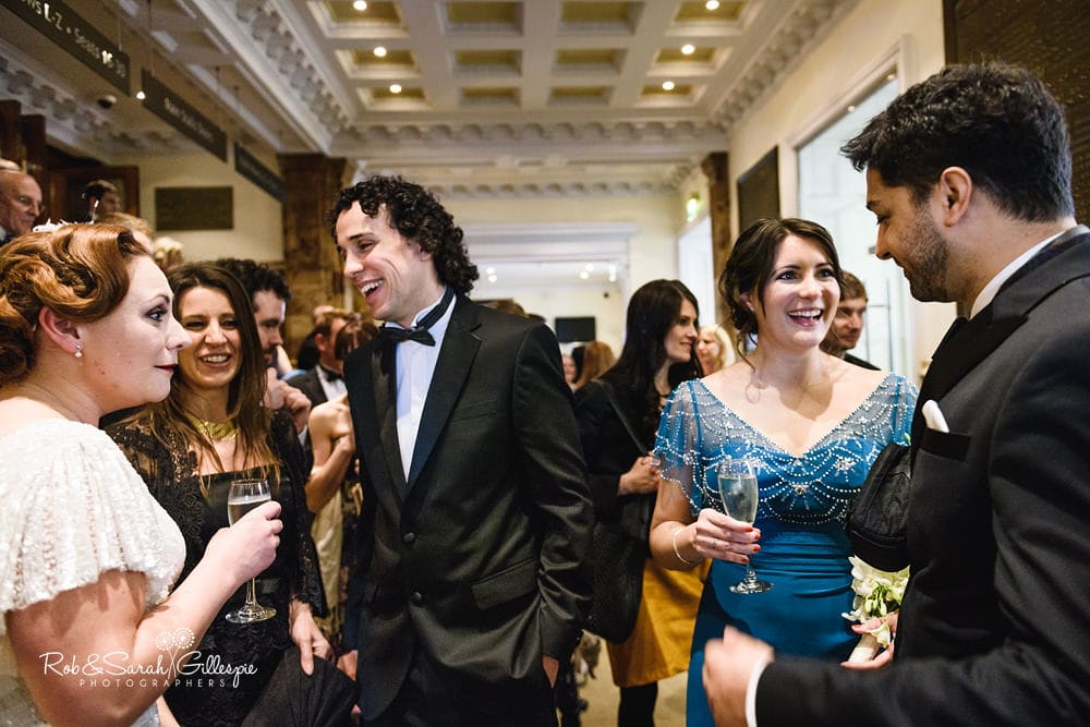 Wedding guests congratulate bride and groom after wedding at Birmingham Town Hall