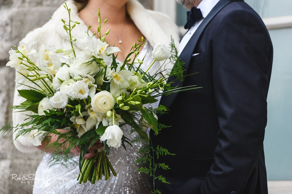 Close-up of bridal bouquet outside Birmingham Town Hall