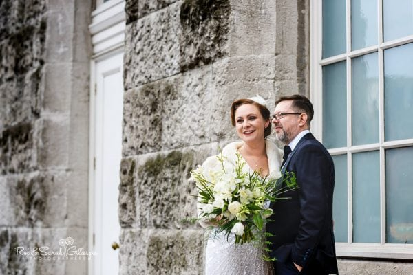 Bride and groom together outside Birmingham Town Hall