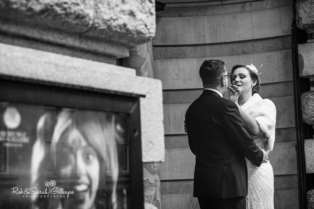 Bride and groom under ornate doorway at Birmingham Museum & Art Gallery