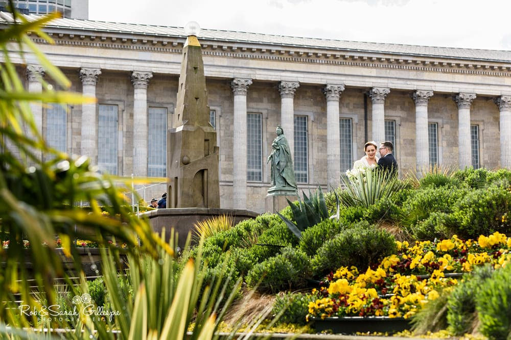 Bride and groom in Victoria Square with Birmingham Town Hall in background