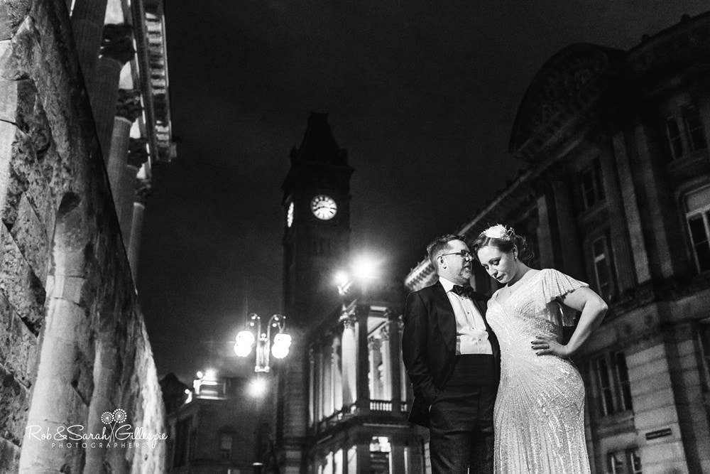 Bride & Groom outside Birmingham Town Hall at night with Birmingham Museum & Art Gallery in background