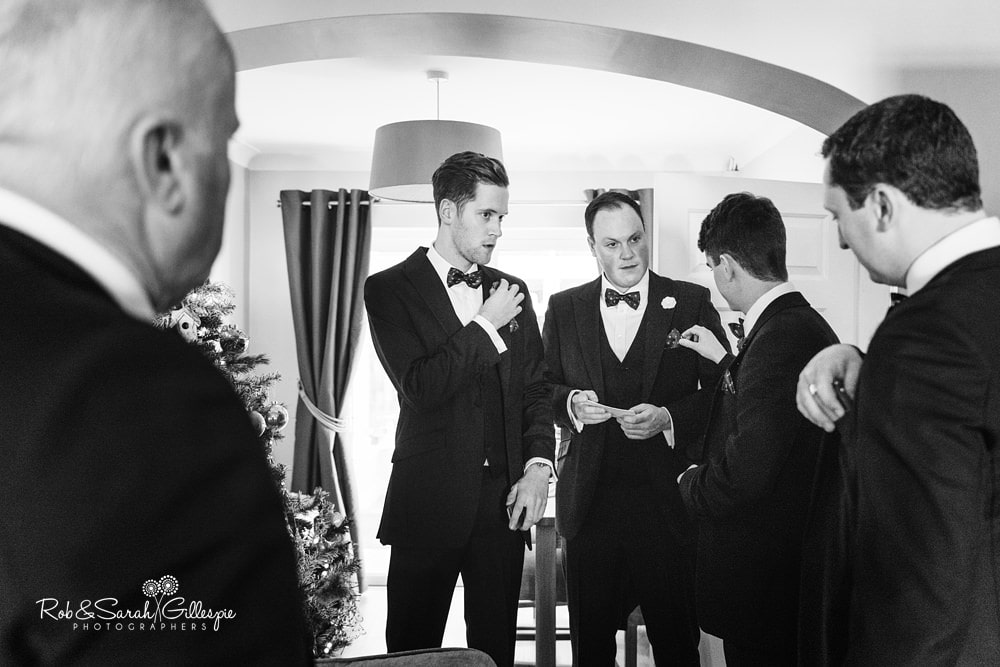 Groom gets ready with friends for wedding at The Boathouse Sutton Coldfield