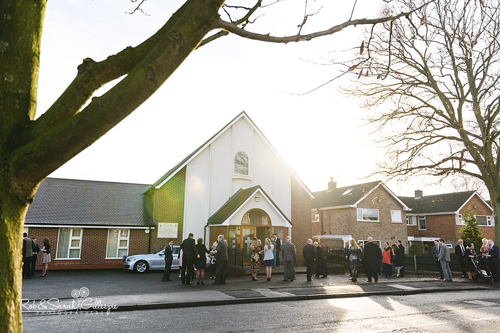 Wedding guests arrive for wedding service at St Annes RC church Streetly