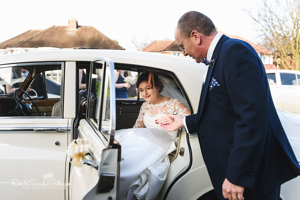 Bride and bridesmaids arrive at St Annes RC church Streetly