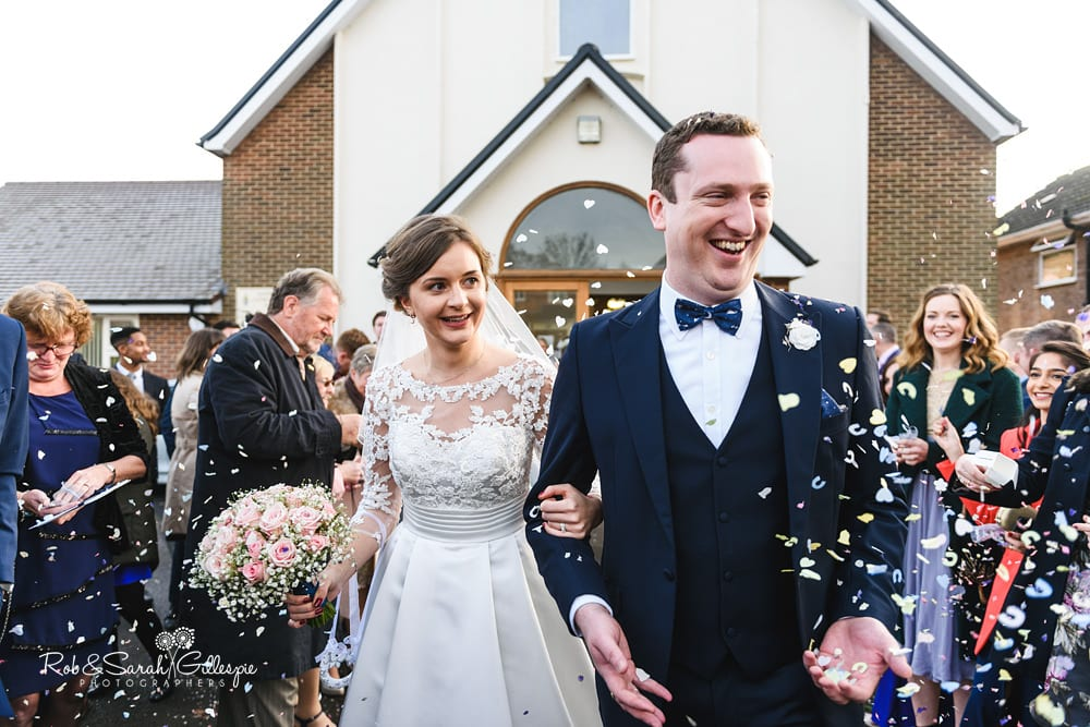 Guests congralate bride and groom at St Annes RC church Streetly