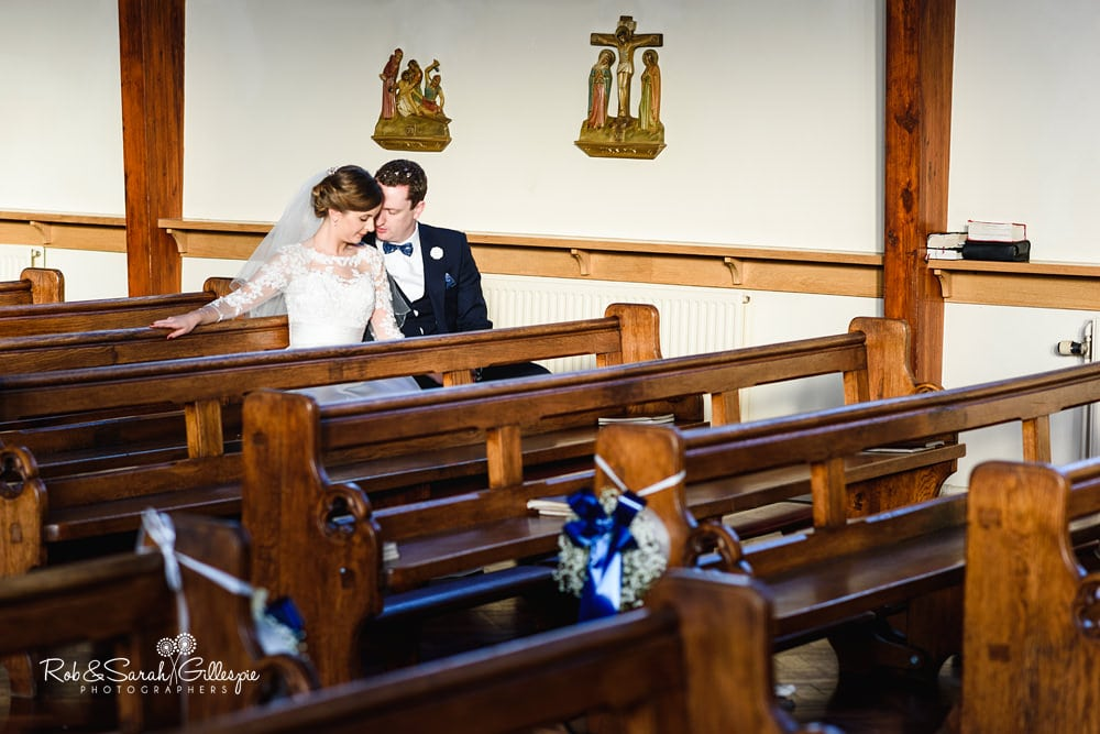 Bride and groom together at St Annes RC church Streetly