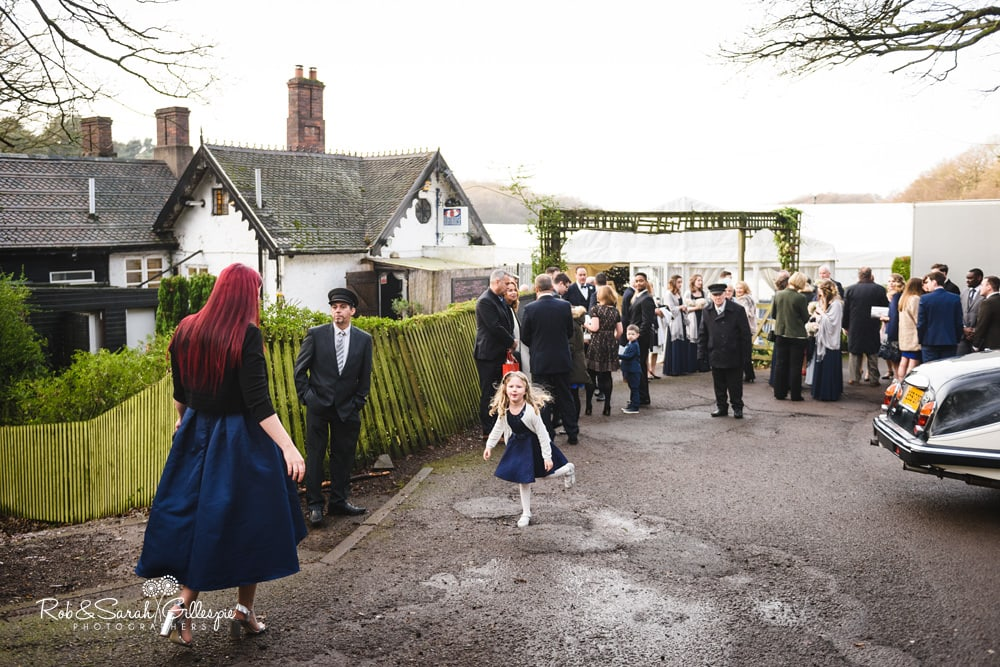 Wedding guests gather outside The Boathouse Sutton Coldfield