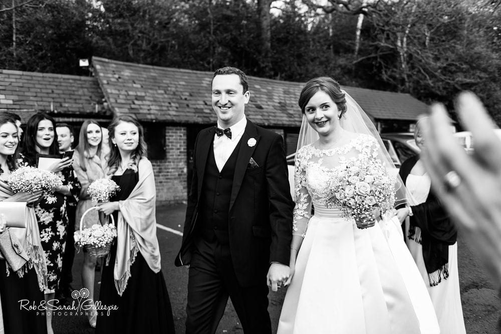 Bride and groom arrive and greet guests at The Boathouse Sutton Coldfield