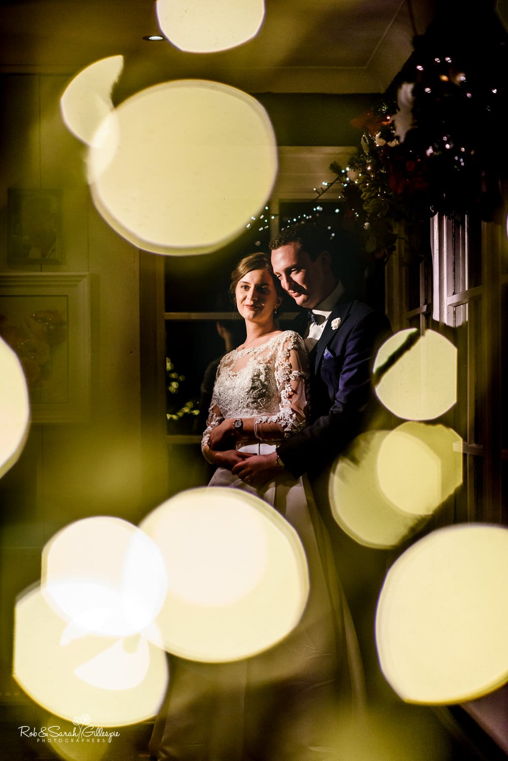 Bride and groom with beautiful lights at The Boathouse Sutton Coldfield