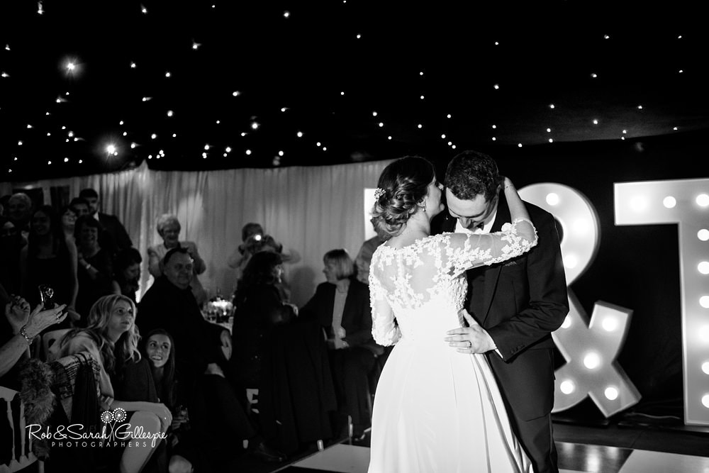Bride, groom and guests dancing at wedding reception at The Boathouse Sutton Coldfield