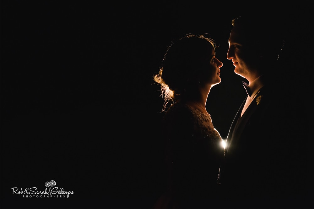 Bride and groom at The Boathouse Sutton Coldfield, outside in the dark with rimlight