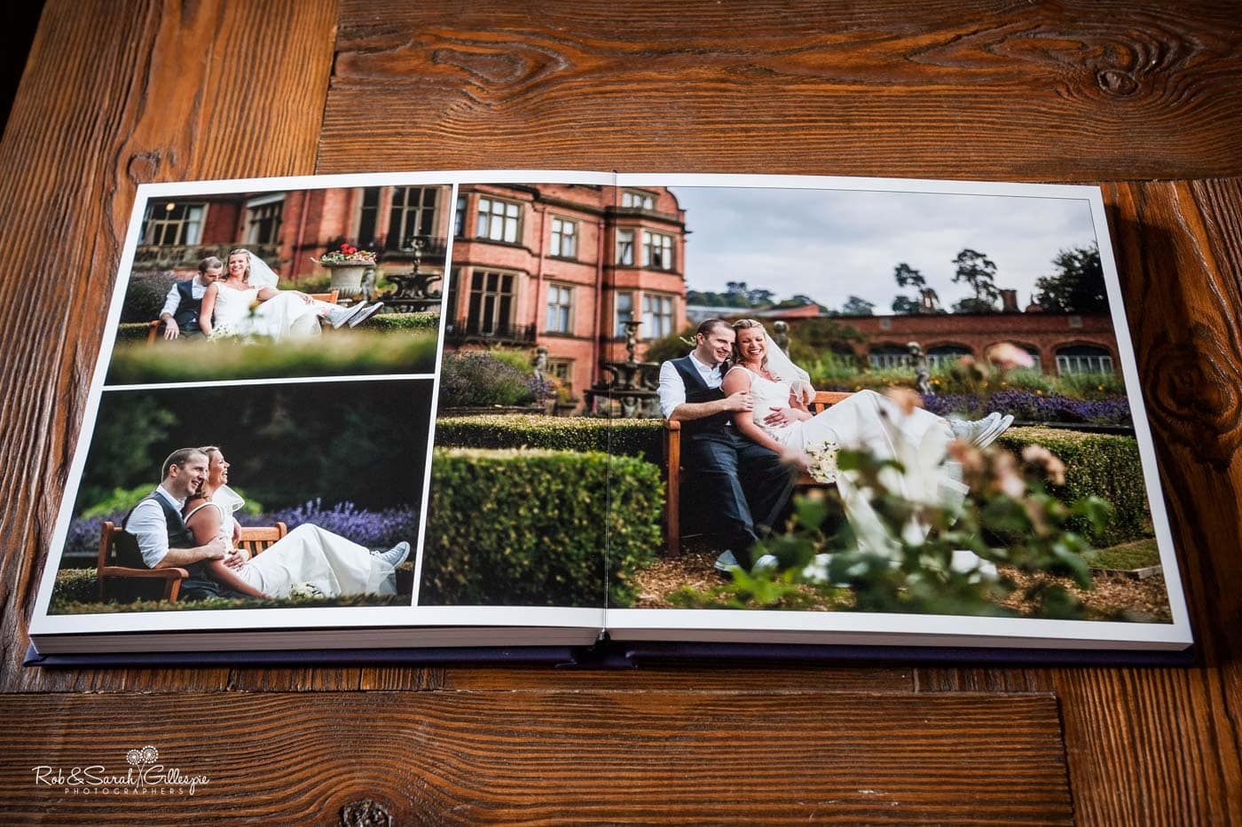 A wedding album opened to show full-width pictures
