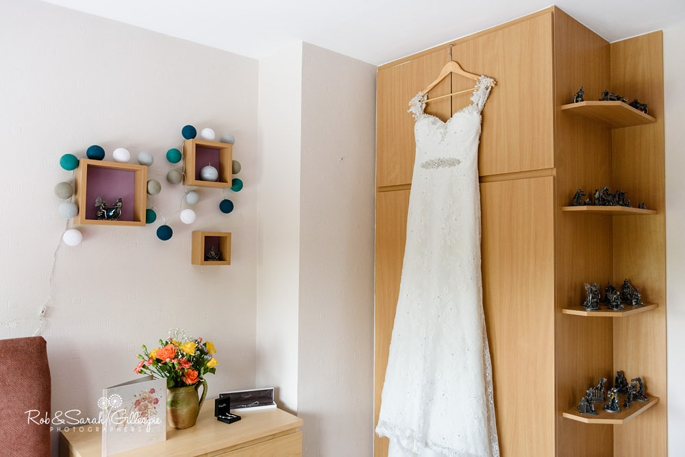 Wedding dress hanging up in bedroom