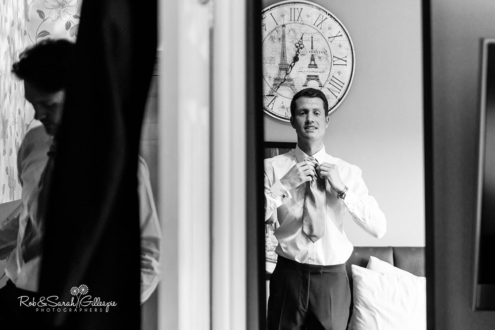 Groom and ushers get ready for wedding