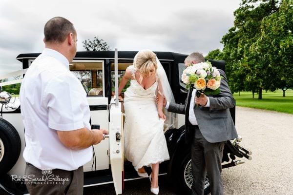 Bride arrives in car at Alrewas Hayes