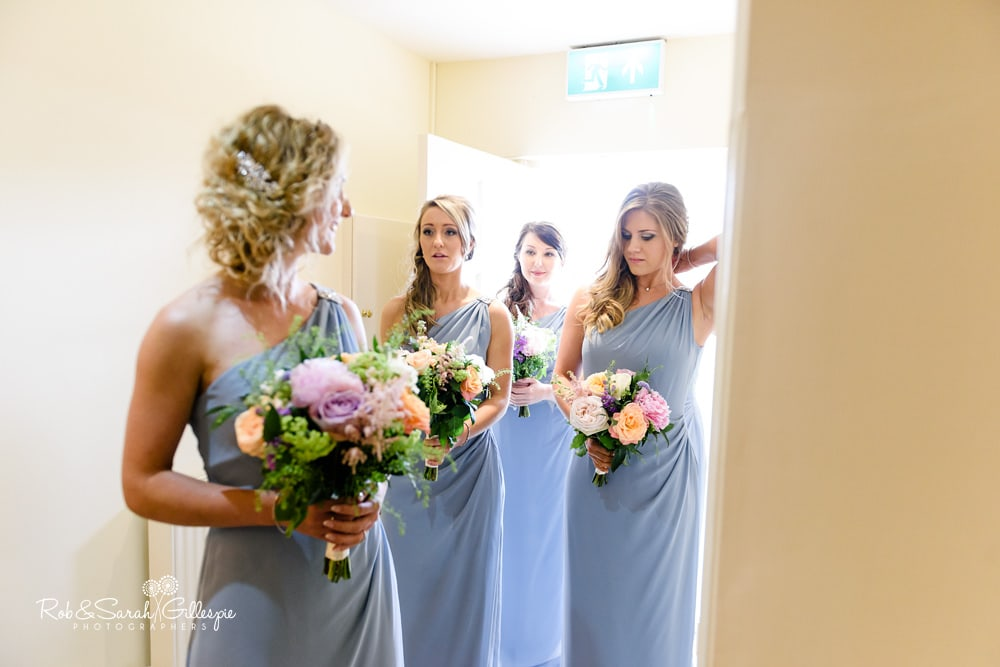 Bride and bridesmaids enter wedding ceremony at Alrewas Hayes