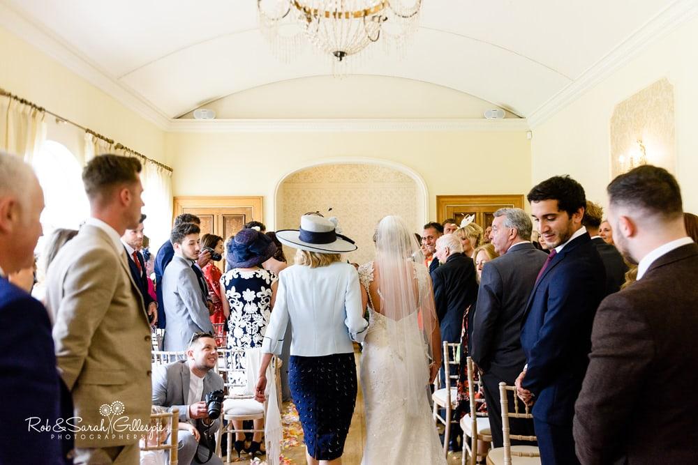 Bride smiles at groom at Alrewas Hayes wedding