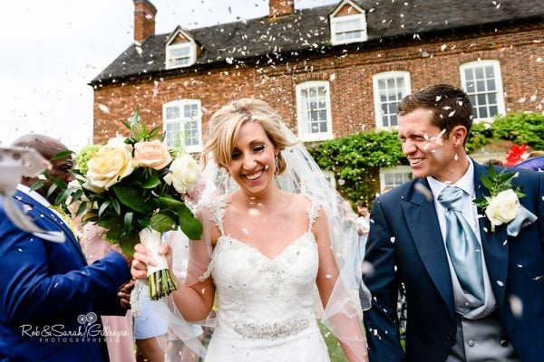 Confetti thrown over bride and groom at Alrewas Hayes wedding
