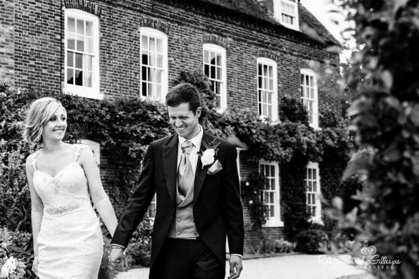 Bride and groom near house at Alrewas Hayes