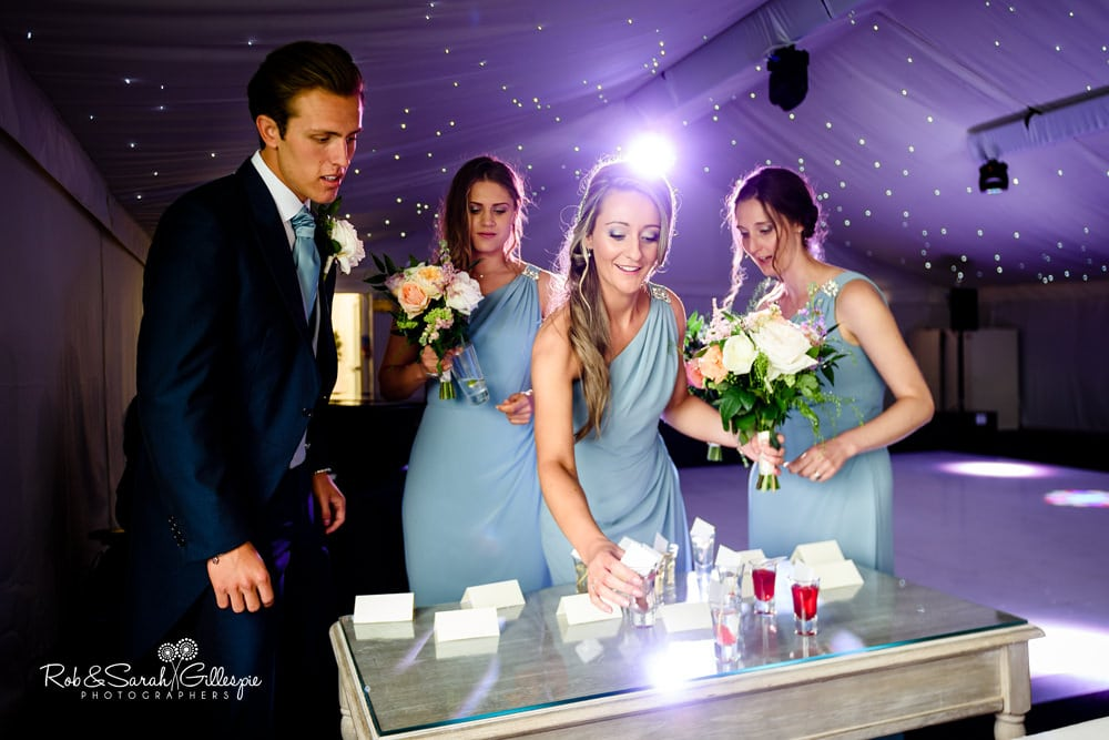 Wedding guests enter marquee for meal at Alrewas Hayes wedding