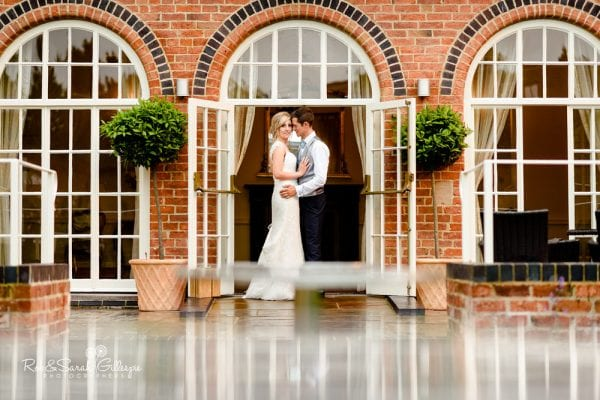 Bride and groom in doorway at Alrewas Hayes wedding venue