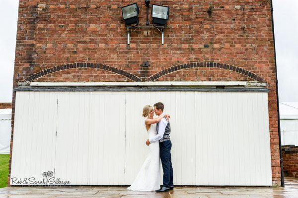 Bride and groom together in front of old wooden doors at Alrewas Hayes wedding venue