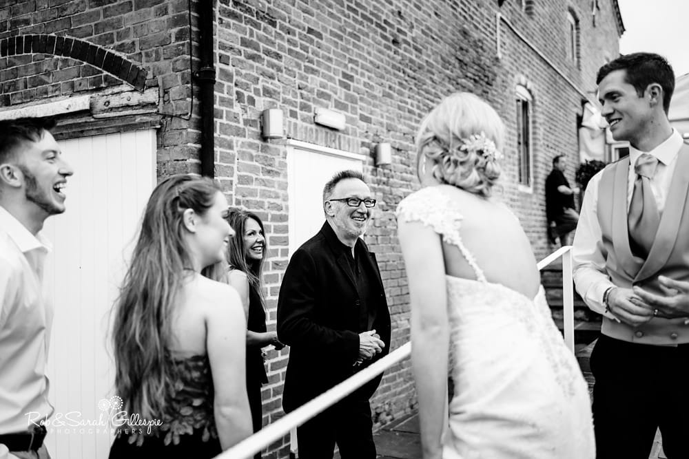 Bride and groom greet evening guests at Alrewas Hayes wedding