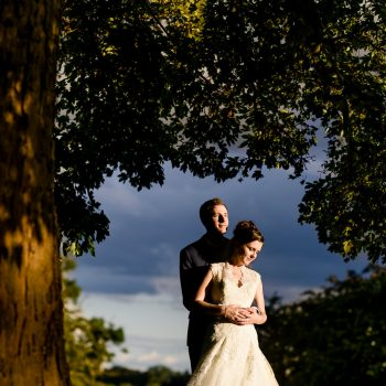 Bride and groom under tree at Ashton Lodge Country House