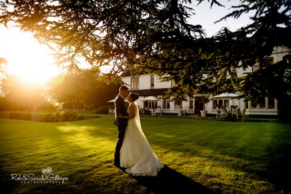 Bride and groom at Ashton Lodge Country House in beautiful evening light