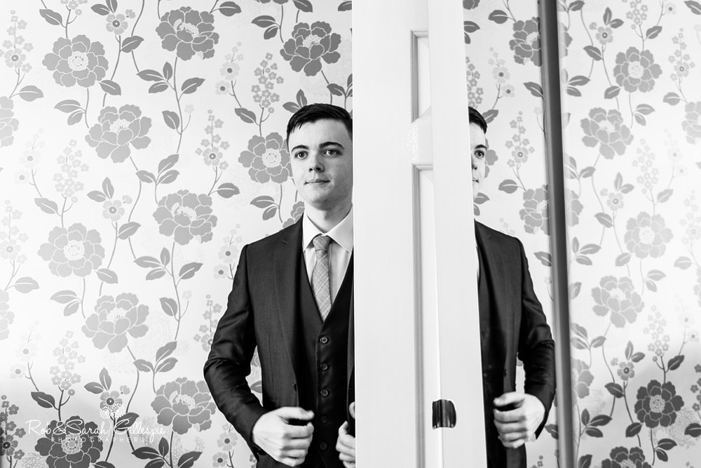 Groomsman gets ready for wedding