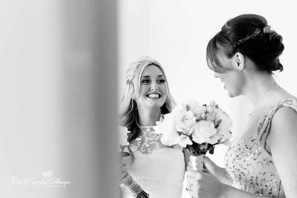 Bride and bridesmaids share laugh before wedding at Olton Friary