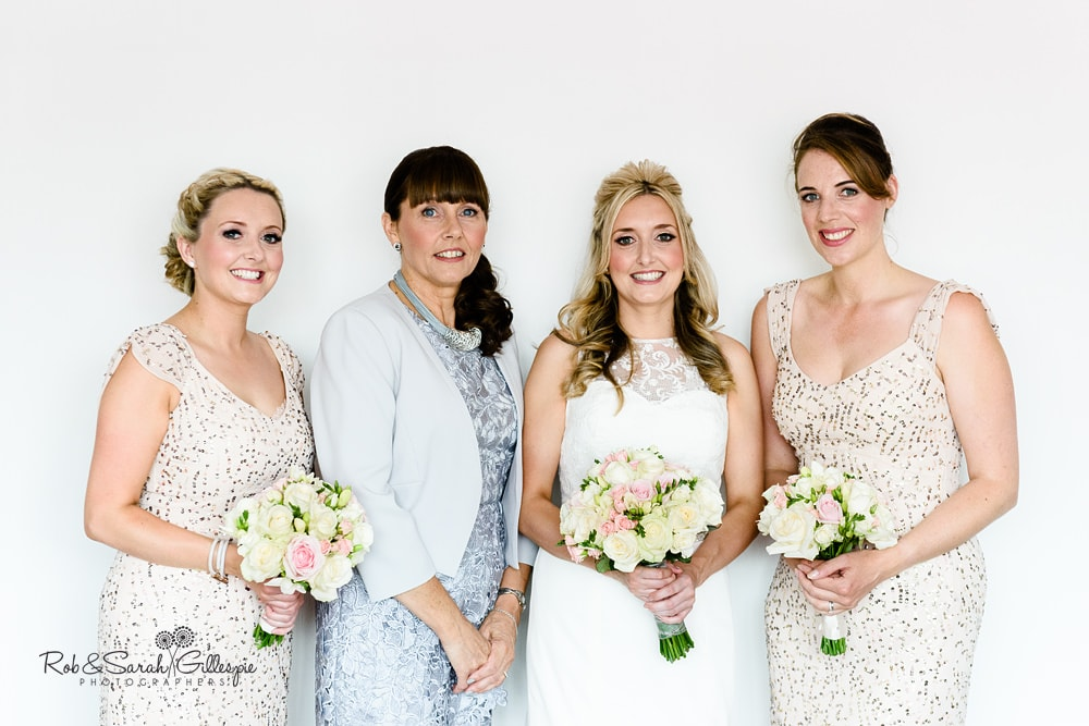 Group photo of bride, bridesmaids and mum