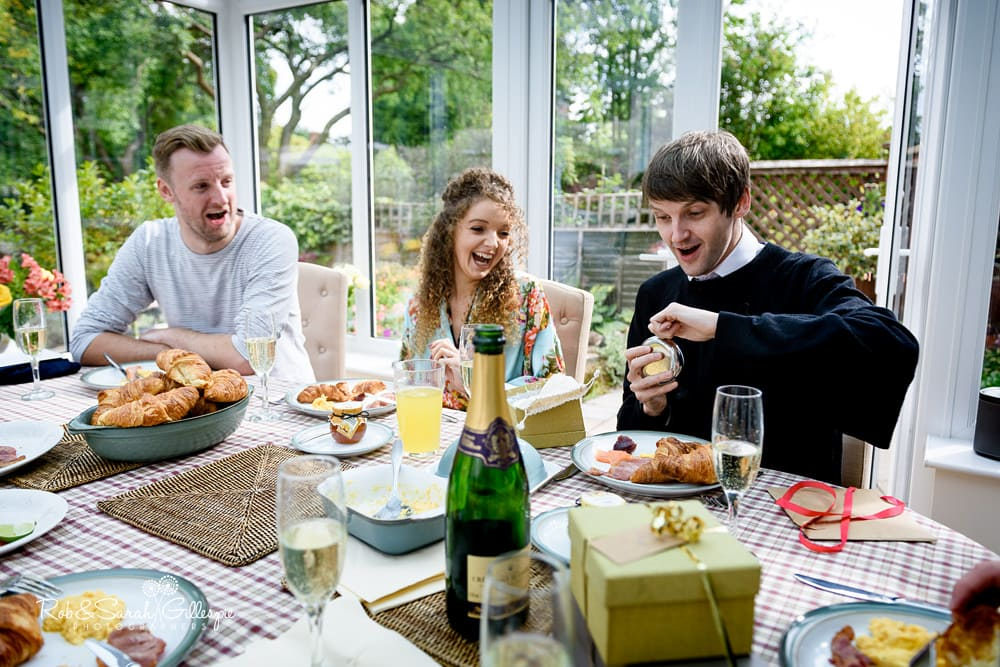 Groom's family prepares breakfast before getting ready for wedding