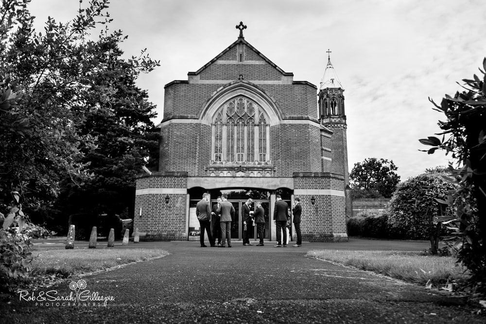 Groom and groomsmen outside Olton Friary
