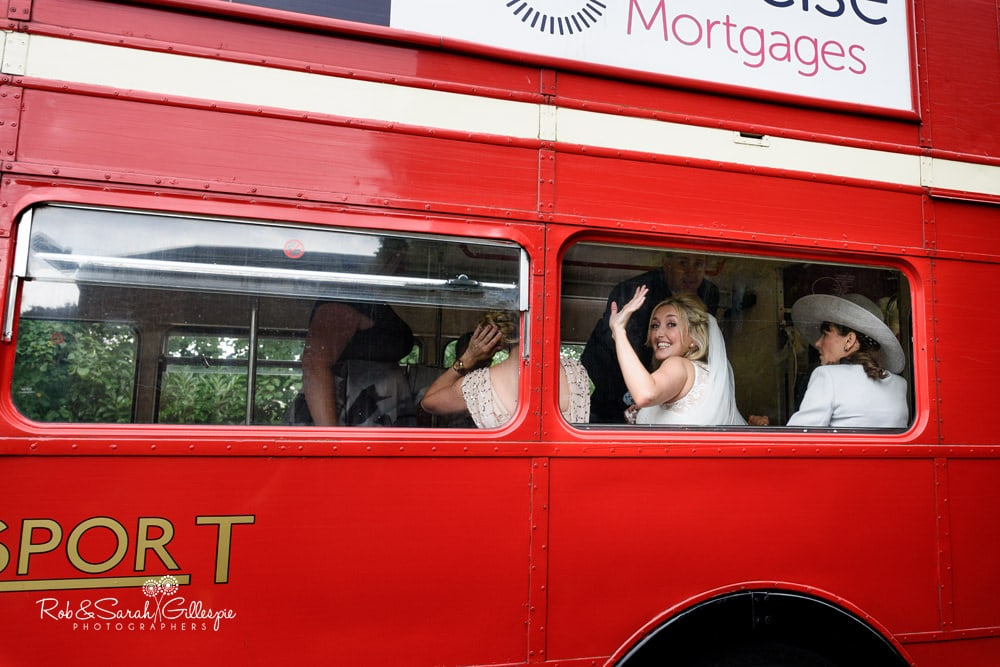 Bride arrives at Olton Friary on red double decker bus