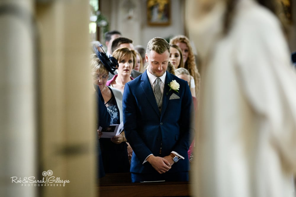 Groom looks nervous before wedding service at Olton Friary