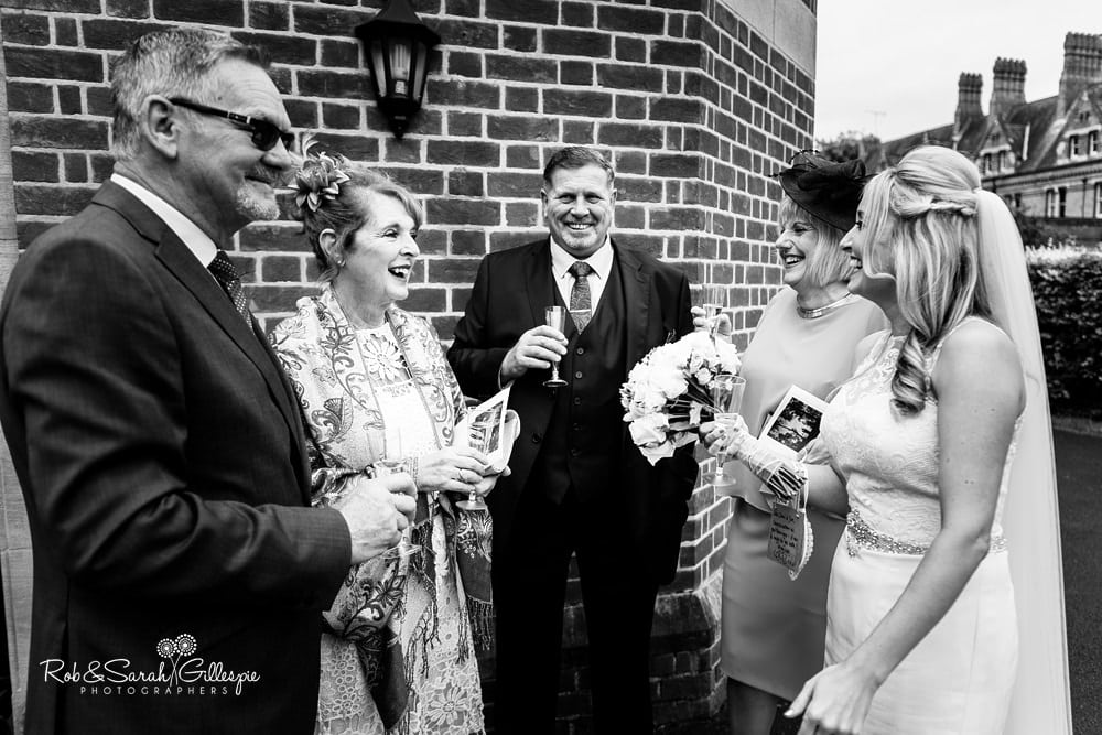 Bride and groom congratulated by wedding guests after Olton Friary service
