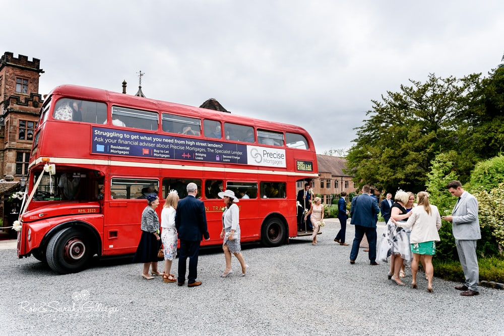 Red double decker bus arrives at New Hall Hotel for wedding reception