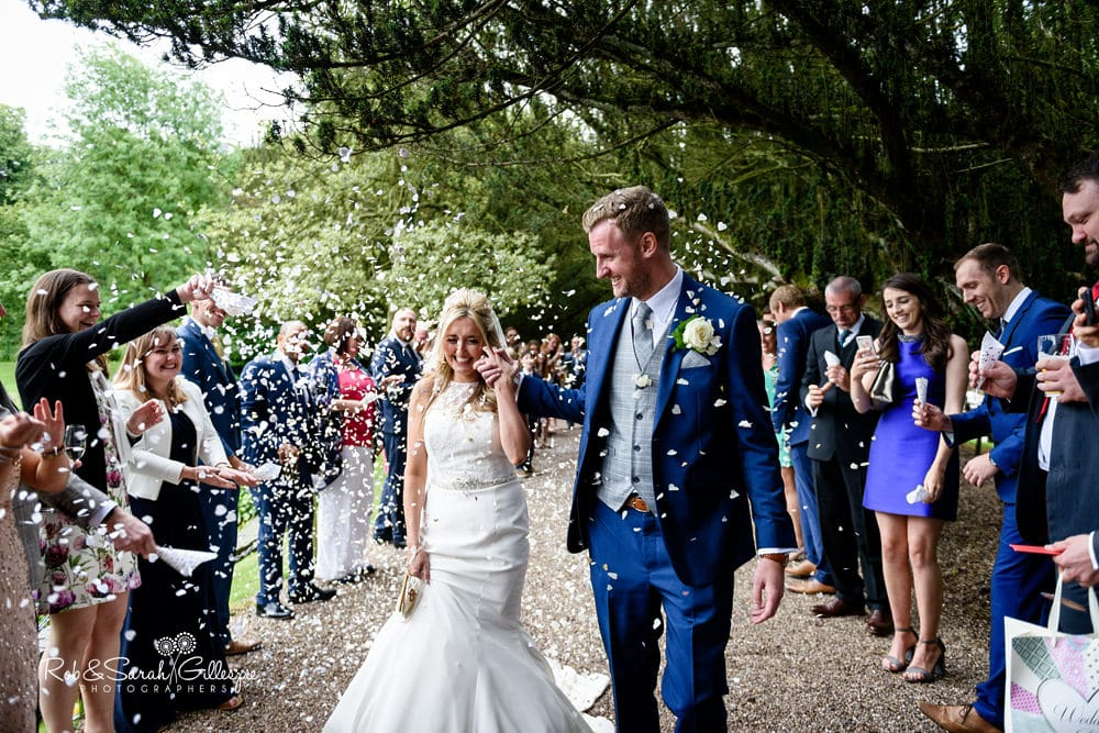 Wedding guests throw confetti at New Hall Hotel